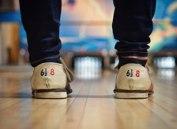 bowling shoes with blurry pins