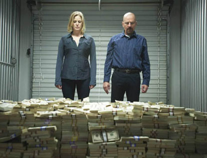 Breaking Bad - Walter and Skyler White staring at piles of money in storage locker