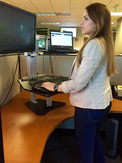 Emily at standing desk