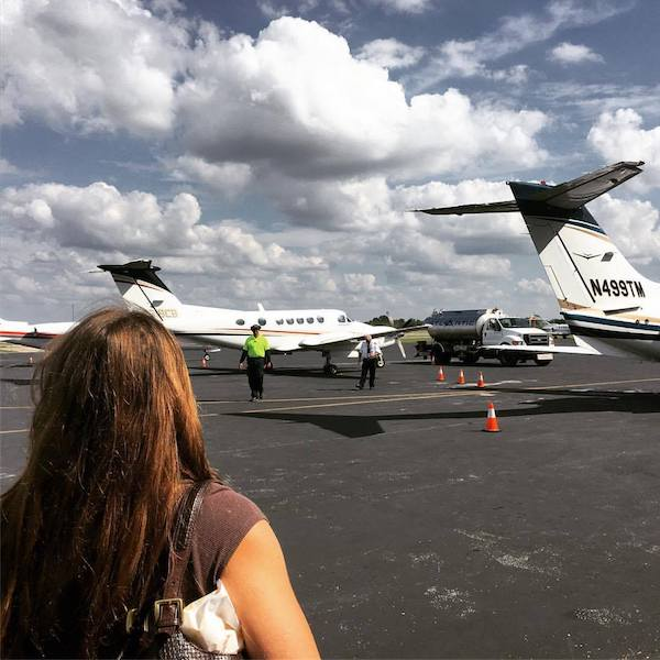 Emily at FBO looking at jets